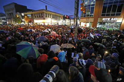 A crowd gathers at the intersection of Murray and Forbes Avenues in the Squirrel Hill section of Pittsburgh during a memorial vigil for the victims of the shooting at the Tree of Life Synagogue, Oct. 27, 2018.