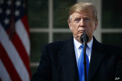 President Donald Trump speaks during an event in the Rose Garden at the White House to declare a national emergency in order to build a wall along the southern border, Feb. 15, 2019, in Washington.