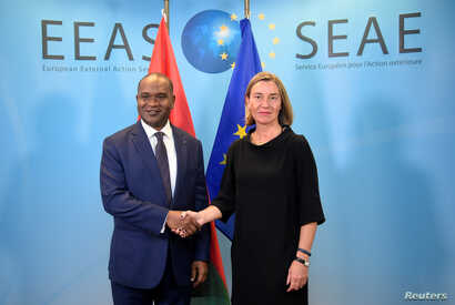 FILE - EU foreign policy chief Federica Mogherini welcomes Burkina Faso Foreign Minister Alpha Barry, left, before a G-5 Sahel Ministerial meeting at EU headquarters in Brussels, Belgium, June 18, 2018.
