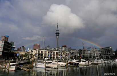 FILE PHOTO - A rainbow appears on the Auckland skyline featuring Sky Tower in New Zealand, July 8, 2017.