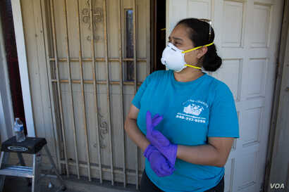 """Elsa Isaula, who runs a small cleaning service in Houston, says inhaling dust from sheetrock becomes inevitable, even when necessary health precautions are taken. """"We feel good because there's a lot of work, but at the same time we feel that itâ€..."""