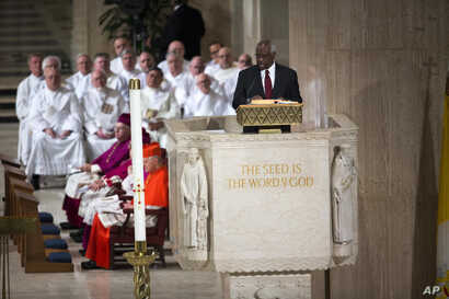Supreme Court Justice Clarence Thomas reads a passage from the New Testament during the funeral mass for Antonin Scalia at the Basilica of the National Shrine of the Immaculate Conception in Washington, Feb. 20, 2016.