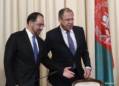 Russian Foreign Minister Sergei Lavrov and his Afghan counterpart Salahuddin Rabbani arrive for a joint news conference following their meeting in Moscow, Russia, Feb. 7, 2017.