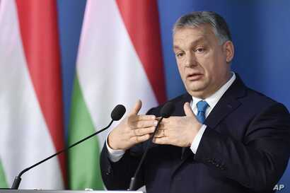 Hungarian Prime Minister Viktor Orban addresses the media during a press conference in the Cabinet Office of the Prime Minister in Budapest, Hungary, Jan. 10, 2019.