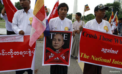 "FILE - People demonstrate against Time magazine in Yangon June 30, 2013 when its cover story dubbed radical Buddhist monk U Wirathu, ""The Face of Buddhist Terror""."
