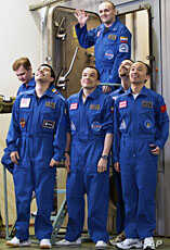 Mars500 experiment crew members react after leaving the mock spaceship in Moscow November 4, 2011