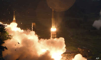 In this photo provided by S. Korea Defense Ministry, South Korea's Hyunmoo II Missile system fire missiles during the combined military exercise between the U.S. and S. Korea at an undisclosed location in S. Korea, July 29, 2017.