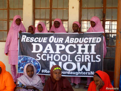 Schoolgirls wait for the arrival of Nigeria's President Muhammadu Buhari at the Goverment girls' science and technical college in Dapchi, Nigeria, March 14, 2018.