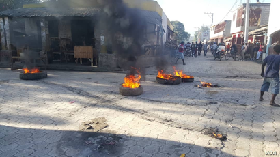 Flaming tires seen early on Feb. 11, 2019, in the streets of Hinche in the center of Haiti.
