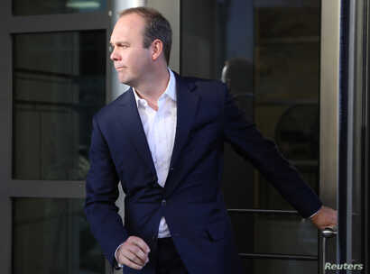 Rick Gates, a former campaign official for U.S. President Donald Trump, departs U.S. District Court in Washington, Oct. 30, 2017.