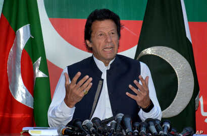 Pakistan's opposition leader Imran Khan speaks during a press conference in Islamabad, Pakistan, Sunday, April 10, 2016. Khan called on Prime Minister Nawaz Sharif to resign.