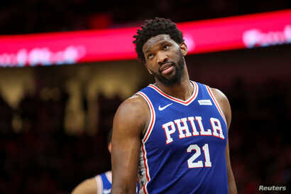 FILE - Philadelphia 76ers center Joel Embiid reacts during a basketball game in Atlanta, March 23, 2019.