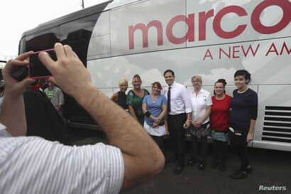 U.S. Senator and Republican presidential candidate Marco Rubio poses for a photo with supporters, during a campaign stop in Hudson, Fla., March 12, 2016.