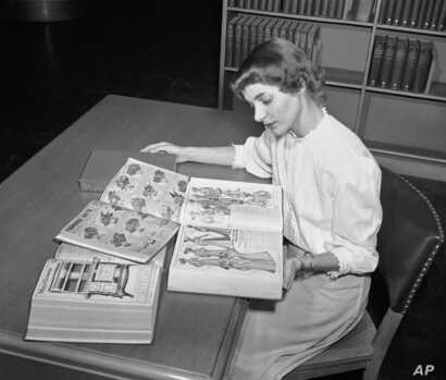 In an undated file photo, a librarian at the Chicago Public Library studies early Sears Roebuck catalogs in the library's collection in Chicago.