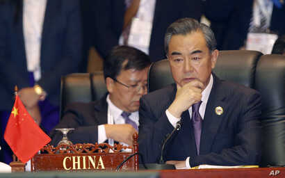 China's Foreign Minister Wang Yi, attends the 23rd ASEAN regional retreat meeting in Vientiane, Laos, July 26, 2016.