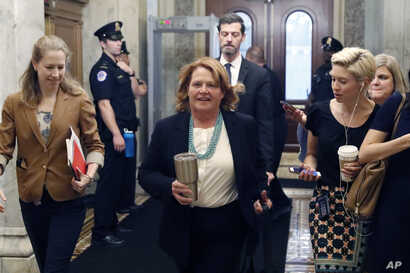 Sen. Heidi Heitkamp, D-N.D., arrives before a vote to advance Brett Kavanaugh's nomination to the Supreme Court, on Capitol Hill, Oct. 5, 2018 in Washington.