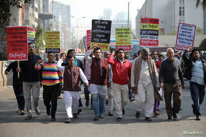 FILE - Activists of the leftist alliance join in a rally to demand a new election under caretaker government, in Dhaka, Bangladesh, Jan. 3, 2019.