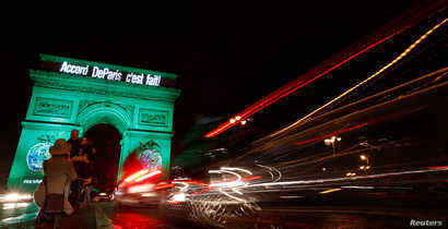 "The Arc de Triomphe is illuminated in green with the words ""Paris Agreement is Done,"" to celebrate the Paris U.N. COP21 Climate Change agreement in Paris, France, Nov. 4, 2016."
