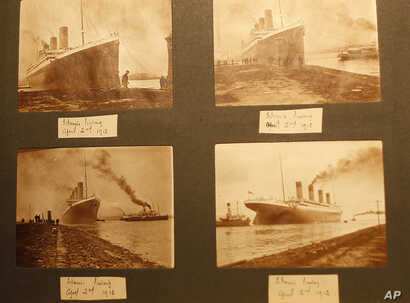 Photographs of the Titanic are displayed in a family album at the Transport museum in Belfast, Northern Ireland, Oct. 14, 2014.