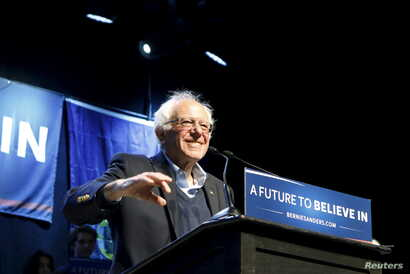 FILE -- U.S. Democratic presidential candidate and U.S. Senator Bernie Sanders smiles as he waves to supporters at a campaign rally in Portland, Maine, on March 2, 2016.