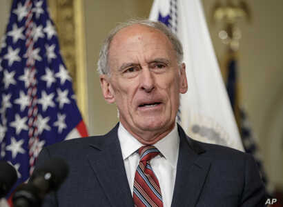 Director of National Intelligence Dan Coats speaks on Capitol Hill in Washington, March, 16, 2017, after being sworn in by Vice President Mike Pence.