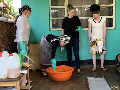 An organic soap making session is attended by women living with albinism in Nansana, Wakiso district in Uganda.