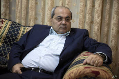 FILE - Arab lawmaker Ahmad Tibi speaks during an interview with the Associated Press at his home in Jerusalem, March 6, 2019.