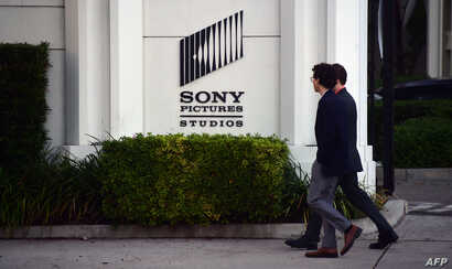 FILE - Pedestrians walk past an exterior wall of Sony Studios in Los Angeles, California, Dec. 4, 2014. That year, Sony became the victim of a cyber hack by North Korean operatives from the Lazarus Group.