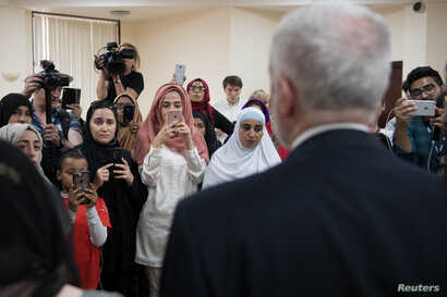 Britain's opposition Labour Party leader, Jeremy Corbyn, meets local people in Finsbury Park Mosque, near the scene of an attack, in London, Britain, June 19, 2017.