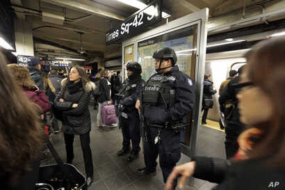 New York City Police Department Transit officers patrol a Times Square subway platform, in New York, March 22, 2016.
