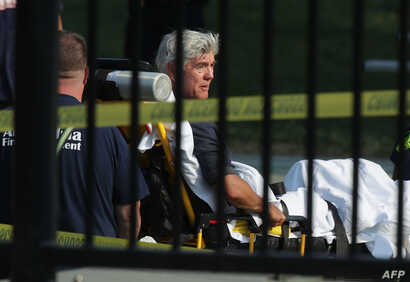 Rep. Roger Williams (R-TX) is wheeled away by emergency medical service personnel from the Eugene Simpson Stadium Park, June 14, 2017 in Alexandria, Virginia.