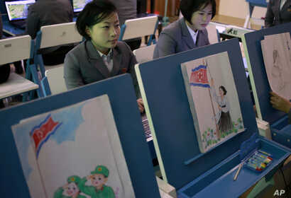 Students make storyboards depicting North Korean flags being raised during a multimedia production class at Pyongyang Teachers' University, a teacher training college, in Pyongyang, North Korea, Jan. 29, 2019.