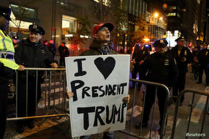 FILE - A supporter of President-elect Donald Trump shouts back at opposing demonstrators during a protest against the President-elect in New York, Nov. 11, 2016.