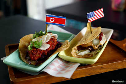 The Rocket Man Taco and the El Trumpo Taco pictured at Lucha Loco in Singapore, June 8, 2018.