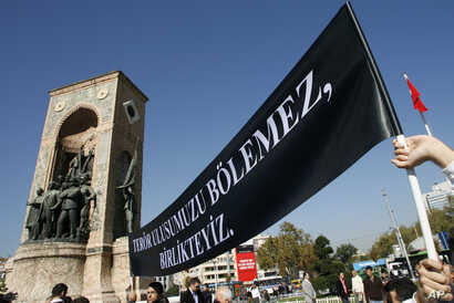 "Lecturers from the Istanbul Technical University display a black banner that reads: ""Terror can't divide our nation, We are together."" during a protest in Istanbul, Turkey, Oct. 17, 2007."
