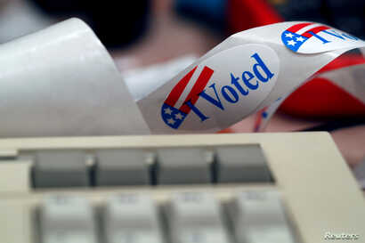 """A """"I Voted"""" sticker is shown by a keyboard in the Voting Machine Hacking Village during the Def Con hacker convention in Las Vegas, Nevada, July 29, 2017."""