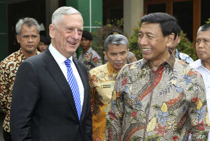 U.S. Defense Secretary Jim Mattis, left, smiles with Indonesian Coordinating Minister for Politics, Security and Law Wiranto after a meeting in Jakarta, Indonesia, Jan. 23, 2018.