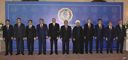 In this photo released by Associated Press of Pakistan, leaders and representatives of the member states of the 10-nation Economic Cooperation Organization pose for group photo during the 13th ECO summit in Islamabad, Pakistan, March 1, 2017.