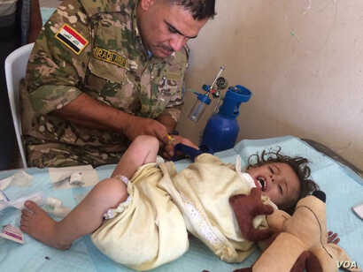 Doctors say children and the elderly are most injured by lack of good food and water in the chaos of the war in Iraq, but they are also most likely to be injured in the violence. As families flee, IS militants fire at them and people that run the slo...