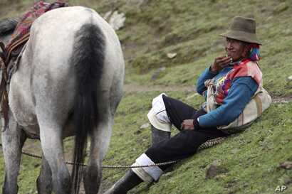 An Andean muleteer rests during a break from guiding tourists to Rainbow Mountain, in Pitumarca, Peru, March 2, 2018.