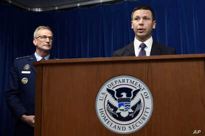 U.S. Customs and Border Protection Commissioner Kevin McAleenan, right, speaks as Commander of United States Northern Command and North American Aerospace Defense Command General Terrence John O'Shaughnessy, left, listens during a news conference in ...