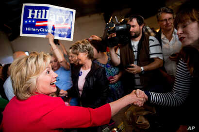 Democratic presidential candidate Hillary Clinton greets patrons at Lone Oak Little Castle Restaurant in Paducah, Ky., May 16, 2016.