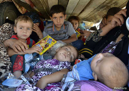 Displaced people, who fled from the violence in the province of Nineveh, arrive at Sulaimaniya province, Iraq, Aug. 8, 2014.