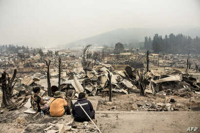 View of the remains of Santa Olga, 350 kilometres south of Santiago, after being devastated by a forest fire, Jan. 27, 2017.