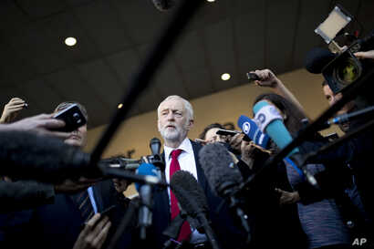 FILE - British Labor party leader Jeremy Corbyn talks to journalists outside the European Commission headquarters in Brussels, Belgium, Sept. 27, 2018.