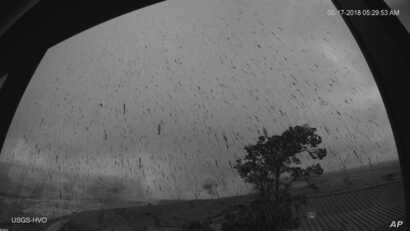 This  May 17, 2018, image provided by the U.S. Geological Survey shows a view of the ash plume resulting from an early morning explosion at Kilauea Volcano, in Hawaii.