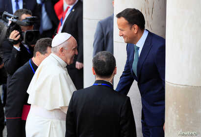 Pope Francis is greeted by Irish Prime Minister Leo Varadkar at Dublin Castle during his visit to Dublin, Ireland, Aug. 25, 2018.