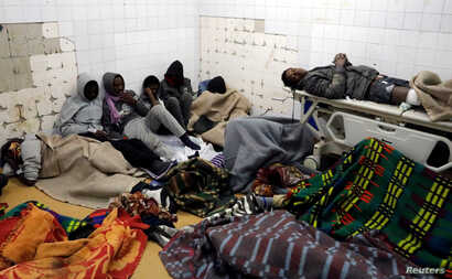 Migrants who were injured in a truck crash are seen at a hospital in Bani Walid town, Libya, Feb. 14, 2018.
