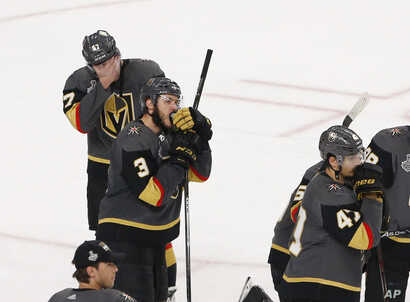 Members of the Vegas Golden Knights watch the Stanley Cup ceremony after the Capitals defeated the Golden Knights 4-3 in Game 5 of the NHL hockey Stanley Cup Finals, June 7, 2018, in Las Vegas.