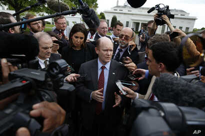 Sen. Chris Coons, D-Del., talks with reporters after all 100 U.S. senators were briefed on North Korea at the Eisenhower Executive Office Building on the White House complex, Washington, April, 26, 2017.